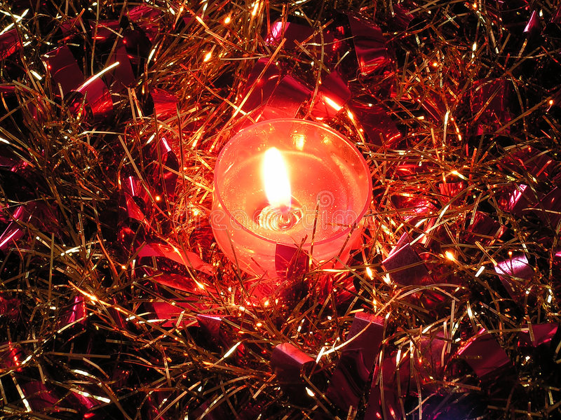 Tinsel With Candle. royalty free stock photo