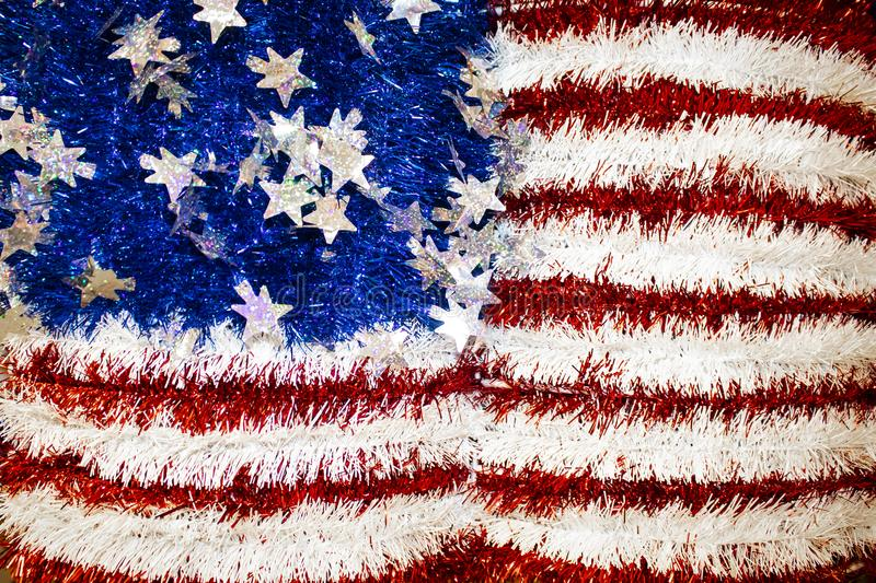 Tinsel and cellophane American flag with sparkly stars background. A Tinsel and cellophane American flag with sparkly stars background royalty free stock photo
