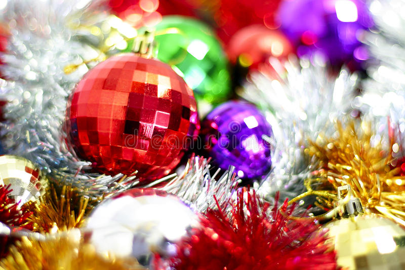Tinsel and Christmas-tree decorations stock photos