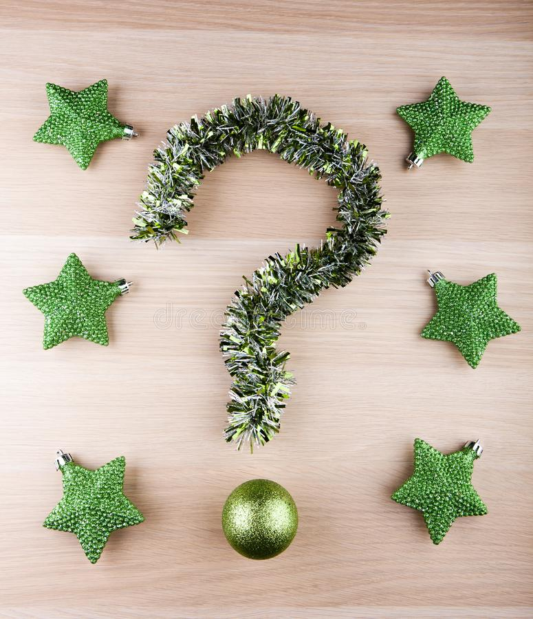 Tinsel question mark new year toy ball green stars. Studio royalty free stock images