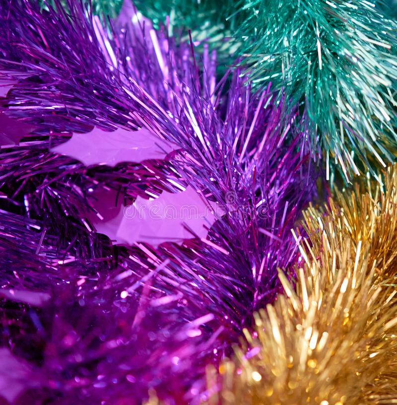 Tinsels in purple blue golden colorful for decoration party or c. Erebration stock image