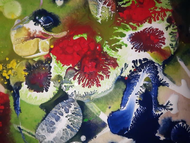 Tinta azul y roja en la pintura fotografía de archivo libre de regalías