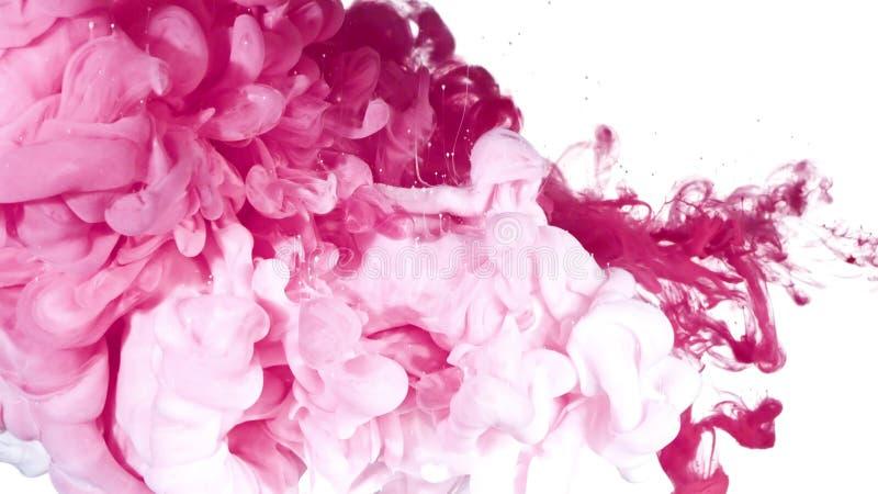 Tinta blanca y rosada en agua imágenes de archivo libres de regalías
