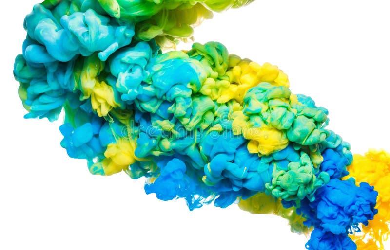 Tinta colorida na água isolada no branco Fundo acrílico abstrato Líquido da pintura da cor fotografia de stock royalty free