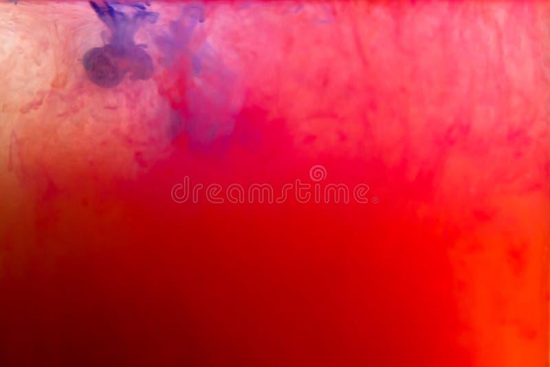 Tinta colorida que remolina en agua imagen de archivo libre de regalías