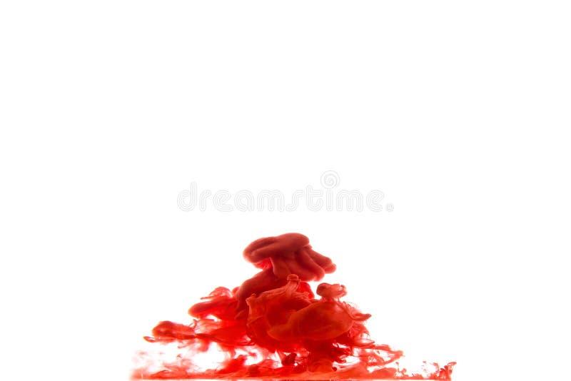 Tinte, die in Wasser wirbelt lizenzfreie stockbilder