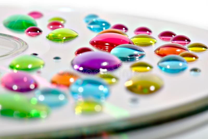 Tintentropfen auf CD lizenzfreie stockfotos