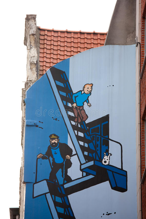 Tintin in Brussels. BRUSSELS, BELGIUM – JULY 26: The famous comic figures Tintin, his dog Snowy and captain Haddock on a fresco in the 'Stoofstraat' on stock photos
