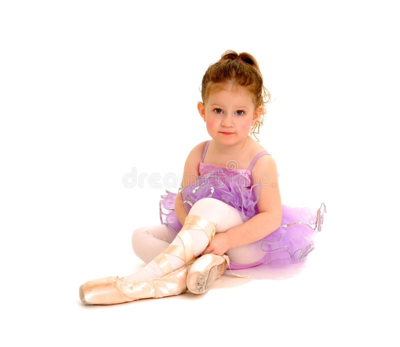 Tiny Ballerina. A tiny ballerina tries on pointe shoes stock images