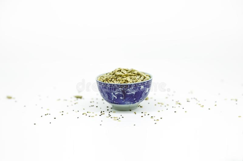 Tiny blue Bowl with sunflower seeds. Sesame and chia on white background with copy space royalty free stock images