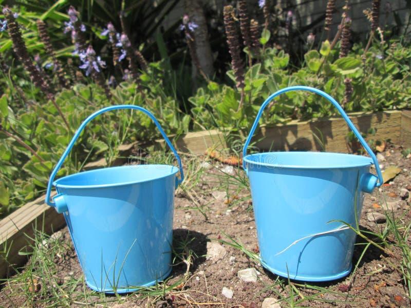 Tiny Buckets. A couple of small toy buckets stock photography