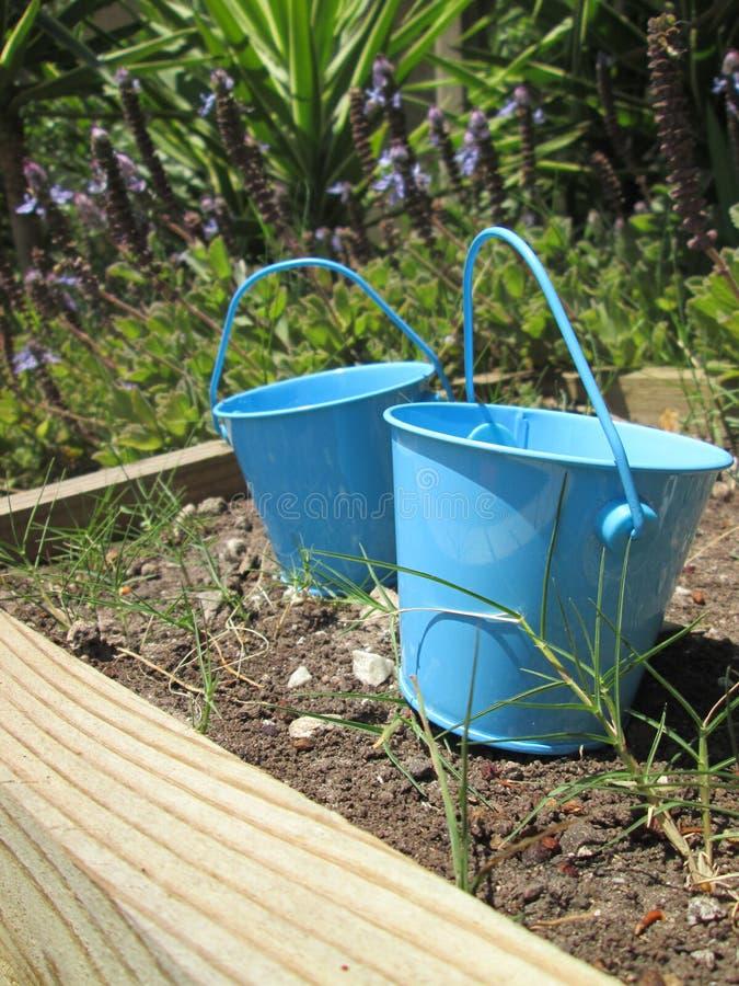 Tiny Buckets. A couple of small toy buckets stock photos