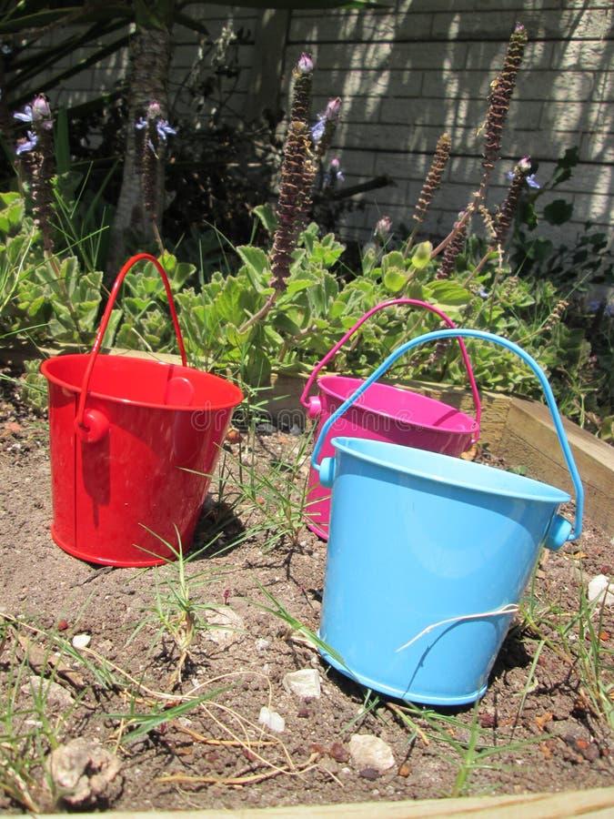 Tiny Buckets. A couple of small toy buckets royalty free stock image