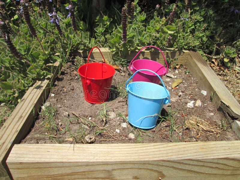 Tiny Buckets. A couple of small toy buckets stock image