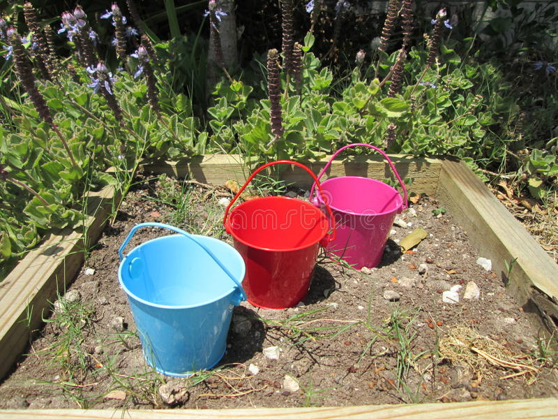 Tiny Buckets. A couple of small toy buckets stock images