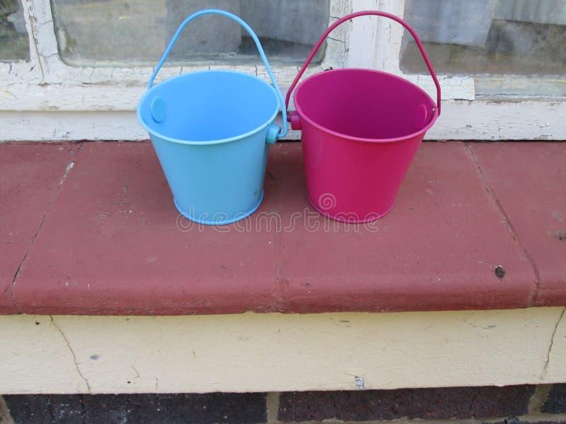 Tiny Buckets. A couple of small toy buckets royalty free stock photography