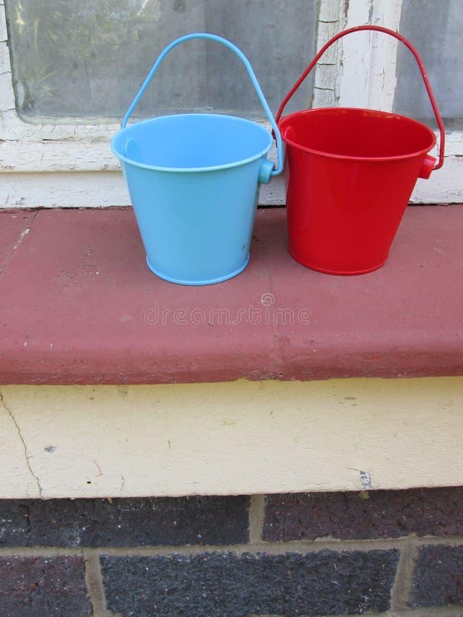 Tiny Buckets. A couple of small toy buckets royalty free stock photo