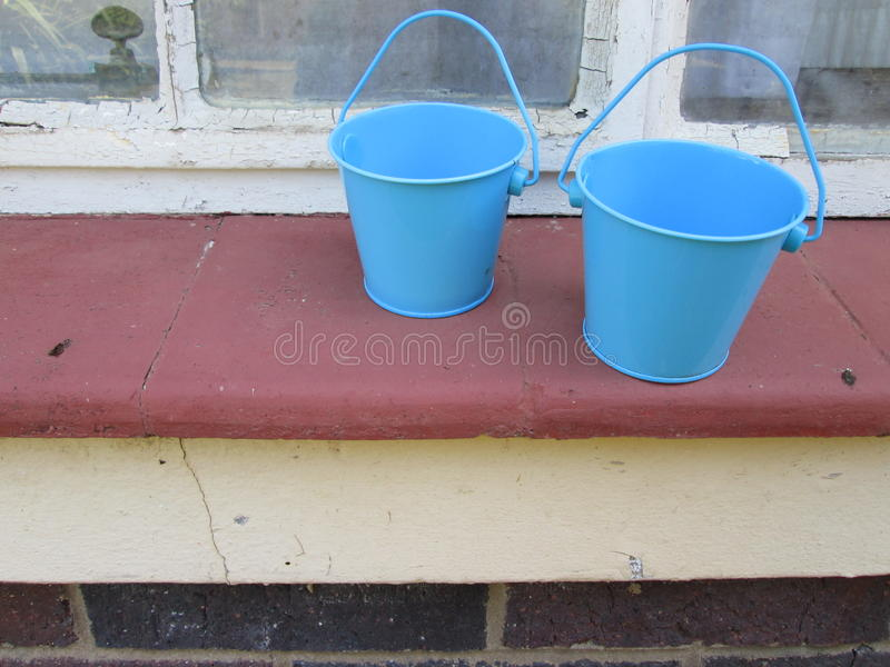 Tiny Buckets. A couple of small toy buckets royalty free stock images
