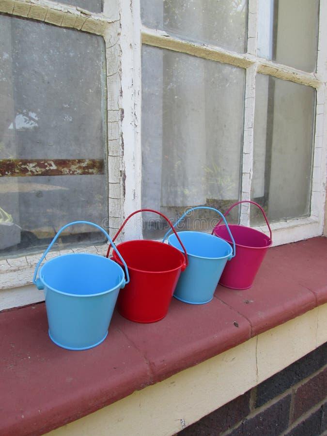 Tiny Buckets. A couple of small toy buckets royalty free stock photos