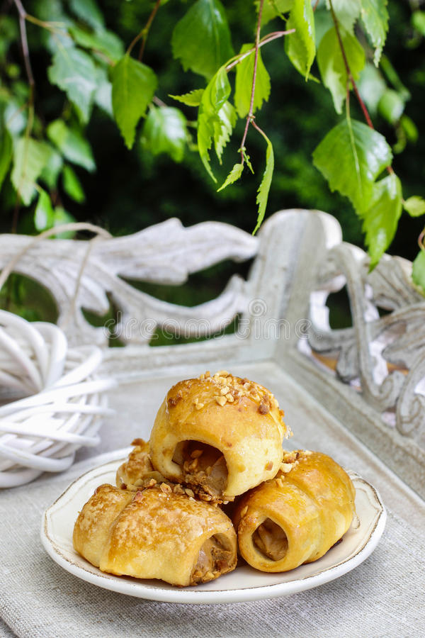 Tiny buns with sweet toffee sauce. Party dessert stock image
