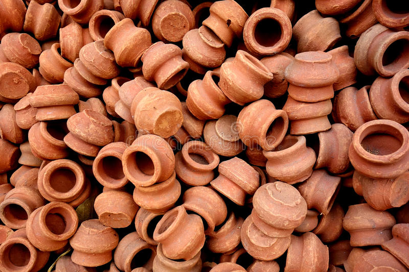 Tiny Clay Pots. This is a closeup image of a jumbled pile of tiny terra-cotta pots in an Indian market royalty free stock photos
