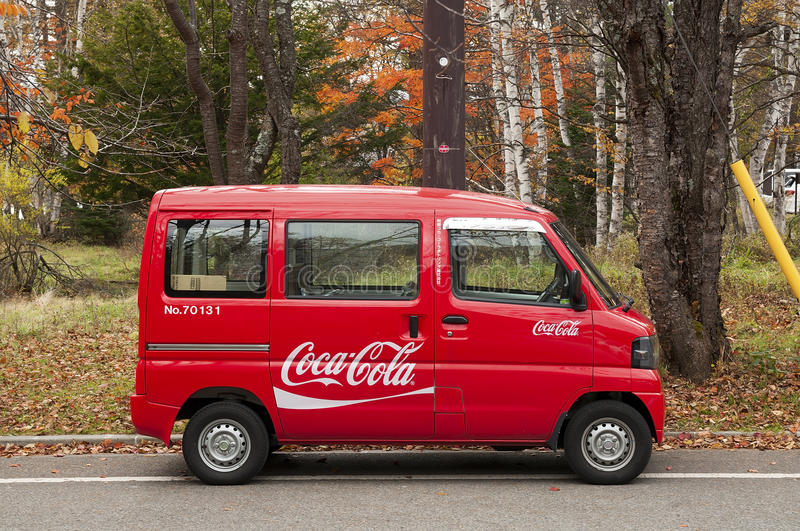 Tiny Coca cola minibus delivers goods to remote locations in Japanese mountains.