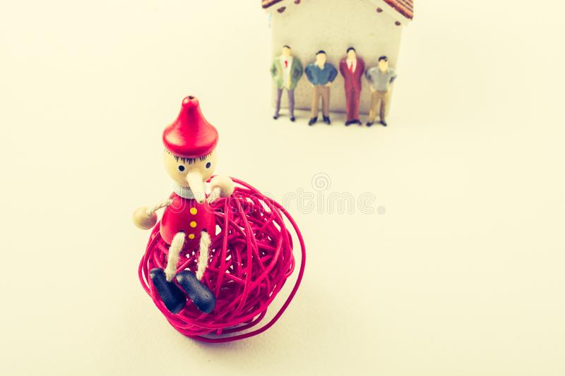 Tiny figurine of man model and puppet pinocchio stock photo