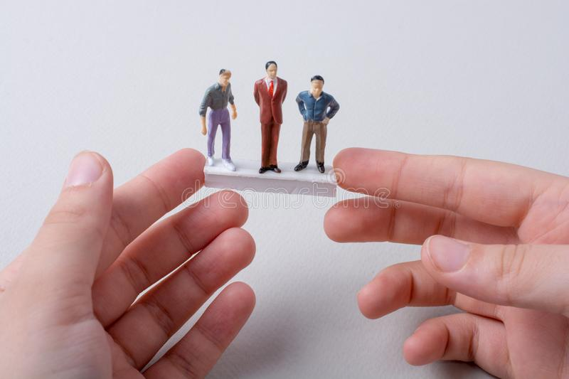 Tiny Figurines Of Men Model In View Stock Image - Image of