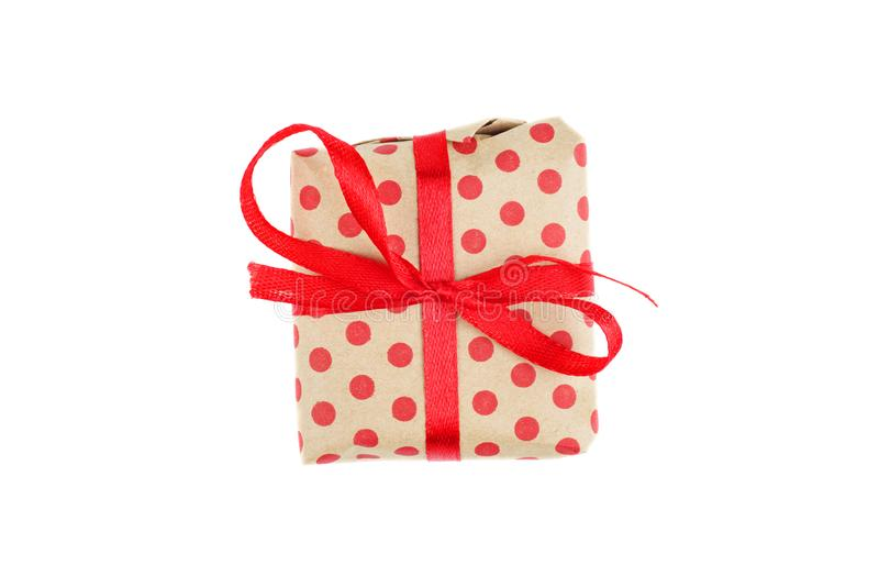 Tiny gift box tied with stripy red ribbon isolated on white background. Gift for Valentine stock photos