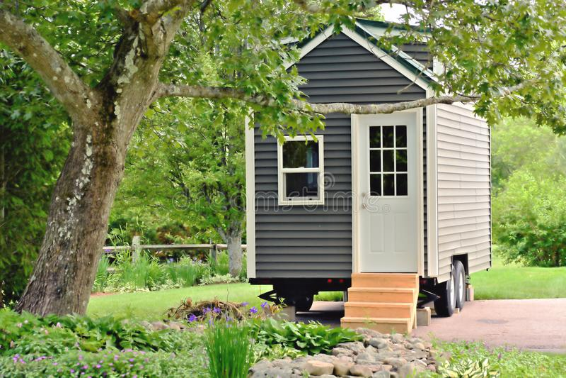 Tiny Gray House on Wheels stock photo