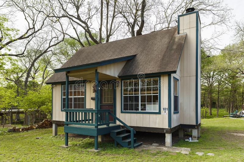 Tiny Home. Wimberley, Texas USA - April 6, 2016: Tiny cottage wood frame home in this small rustic town in the Texas Hill Country stock image