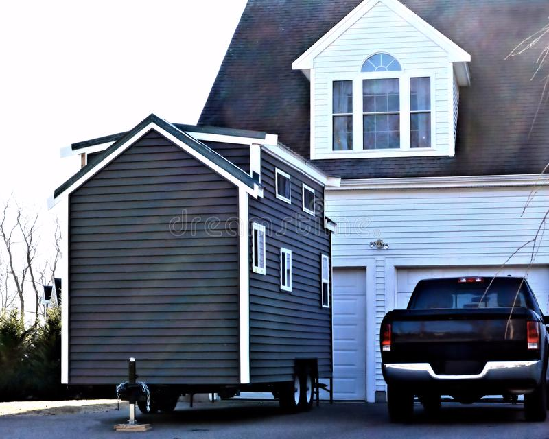 Tiny House Big Garage royalty free stock photography