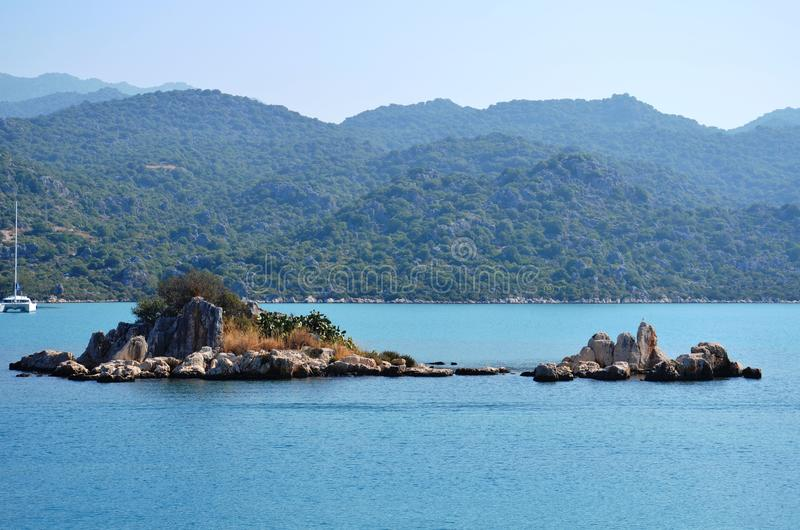 Tiny island in Marmaris, Mediterranean. Tiny island in Marmaris, on the remarkable historical monuments, deep blue stock photography