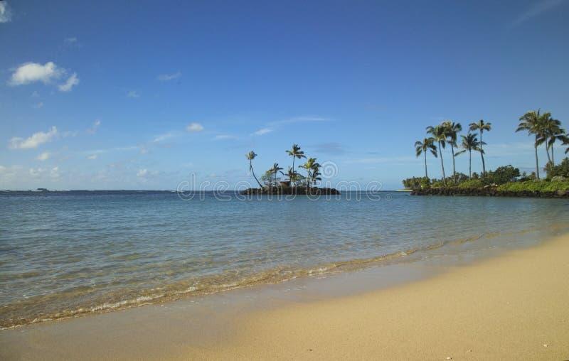 Tiny island off the beach stock photography