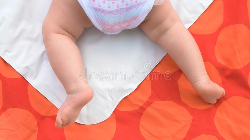 Tiny legs of infant baby girl. stock photography