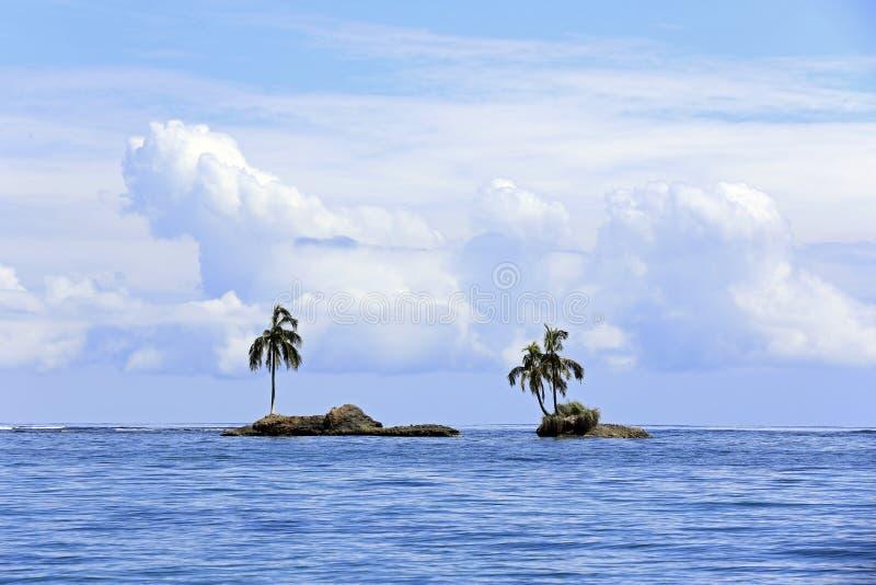 Tiny Palm Tree Islets. Two Tiny Palm Tree Islets Right Outside Zapatilla Sur. Bocas del Toro, Panama royalty free stock images