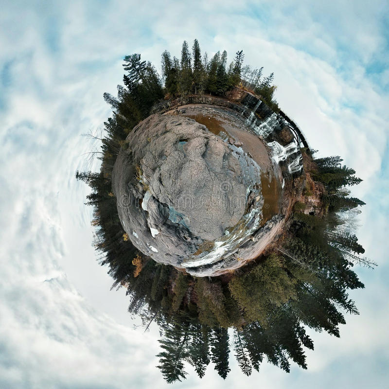 Tiny Planet Pine and Waterfall royalty free stock photos