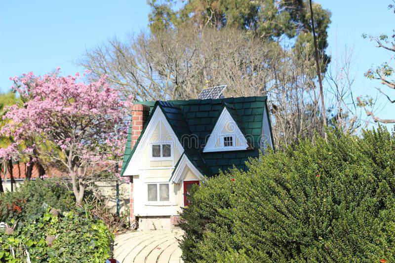 Tiny Play House. A tiny childrens play house in a botanical garden royalty free stock images
