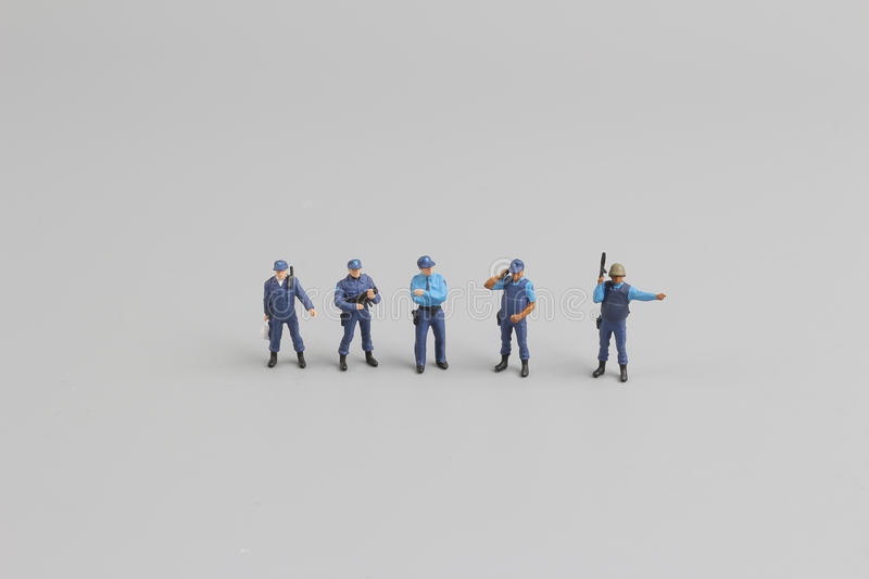 tiny of Police officer wearing protective uniform stock photography