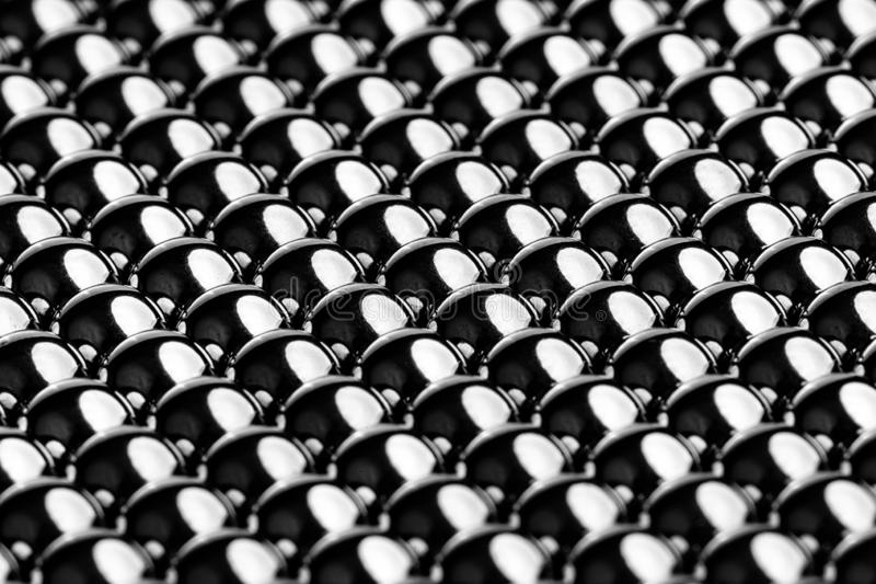 Black balls. Tiny Steel Ball Bearings shined and lined up ready for use royalty free stock image