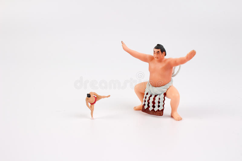 The tiny of Sumo Wrestler. The figure of Sumo Wrestler with white board royalty free stock photos