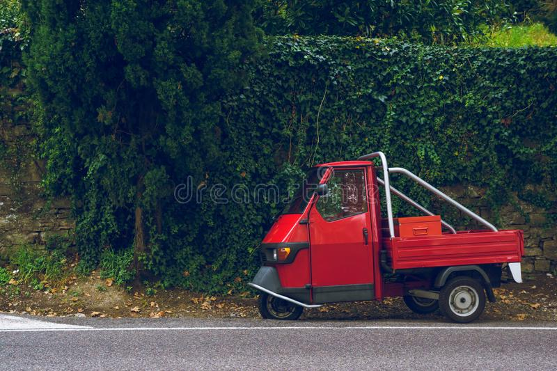 Tiny vintage, oldschool car in green vivid background, typical italian colors royalty free stock photo