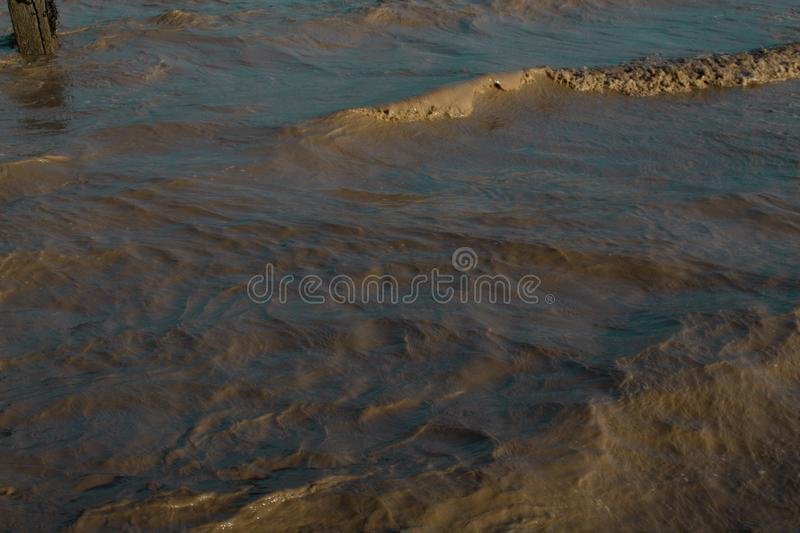 Tiny waves in the sea stock image