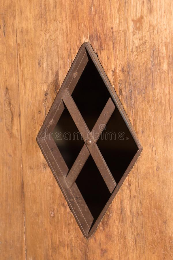 A tiny window into a camera in a dungeon or in a castle royalty free stock images