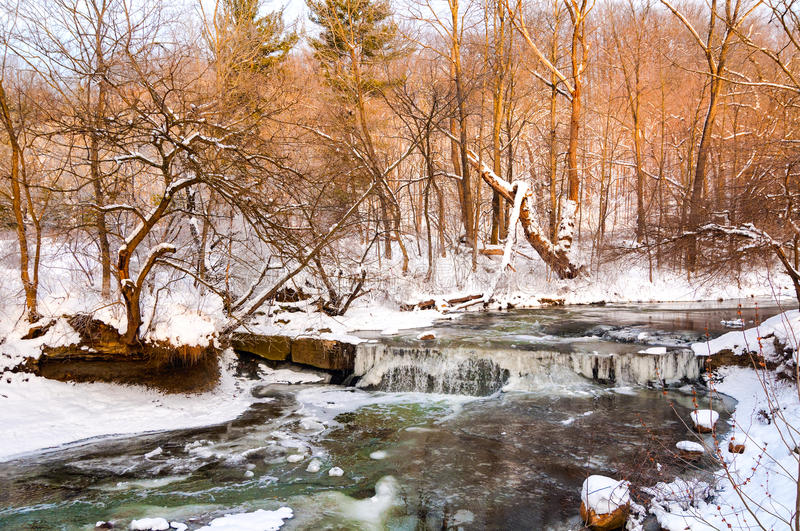 Tiny winter waterfall royalty free stock images