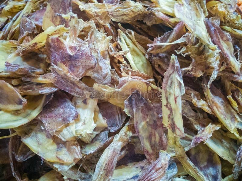 Tioarmade bläckfisken torkades det för att hjälpa inte byte royaltyfria bilder