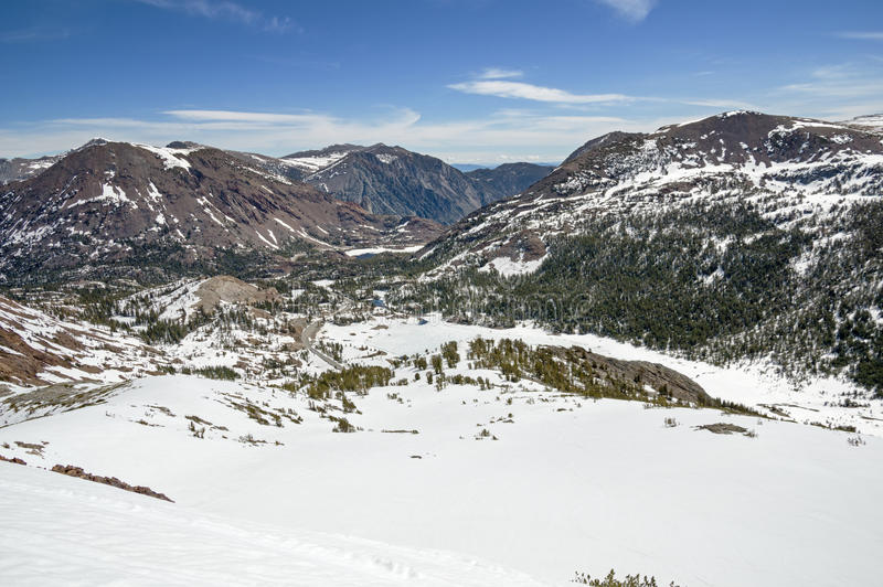 Tioga Pass. View down to the east side of Tioga Pass from Gaylor Peak with snow stock photo
