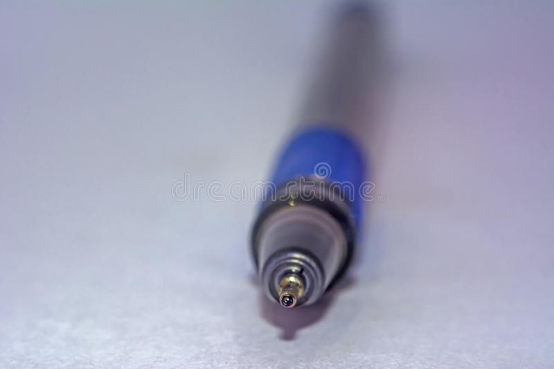 Tip of a blue ball point pen royalty free stock photography