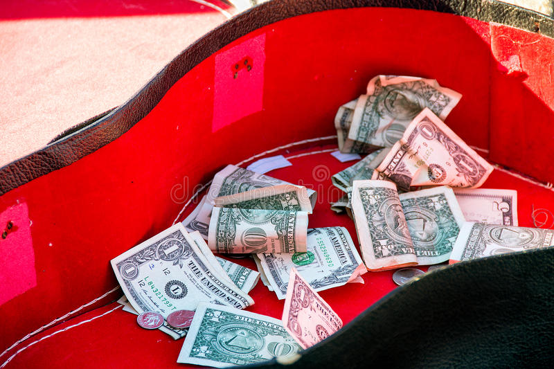 Tip money in guitar case royalty free stock photo