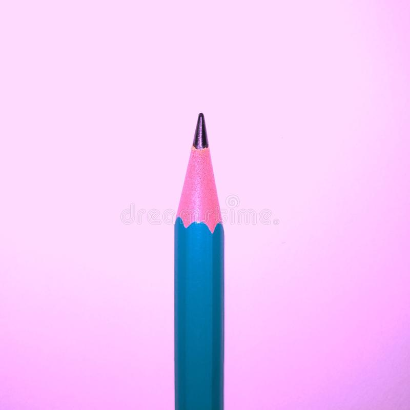 The tip of a sharp sharpened pencil. Against a light background. Macro, visible pencil, triangular shape, place for background stock photography